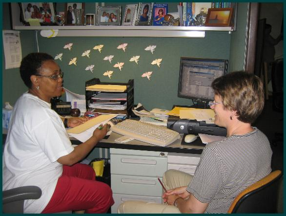 Genell Walls and Lu Johnston at new office desk